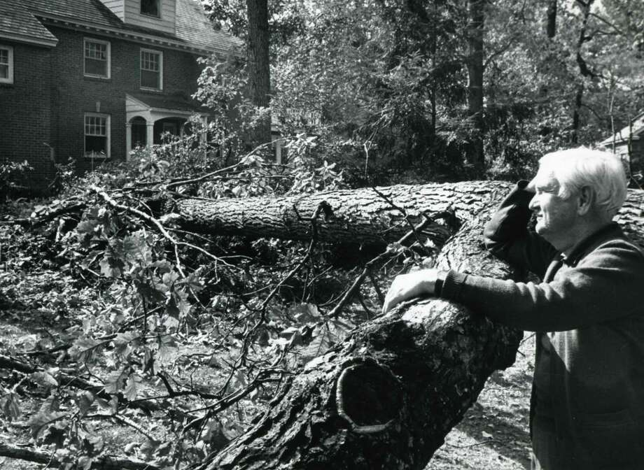 William Fasake outside his home on Baker Ave. in Niskayuna, N.Y., Oct. 7, 1987, where a large oak tree fell following a freak Autumn snowstorm on Oct. 4. (Arnold Le Fevre / Times Union archive)