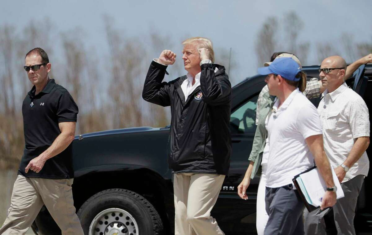 President Donald Trump gestures after arriving at the Luis Muniz Air National Guard Base in San Juan, Puerto Rico, Tuesday, Oct. 3, 2017. Trump is visiting Puerto Rico in the wake of Hurricane Maria. (AP Photo/Evan Vucci) ORG XMIT: XRE104