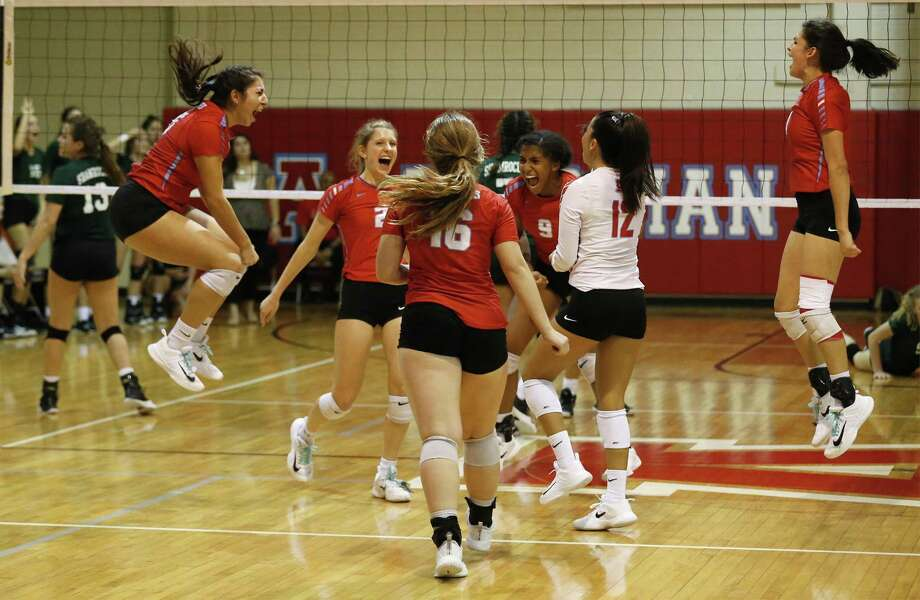 Antonian girls celebrate a point against Incarnate Word in girls volleyball at Antonian on Tuesday, Oct. 3, 2017. (Kin Man Hui/San Antonio Express-News) Photo: Kin Man Hui, Staff / San Antonio Express-News / ©2017 San Antonio Express-News
