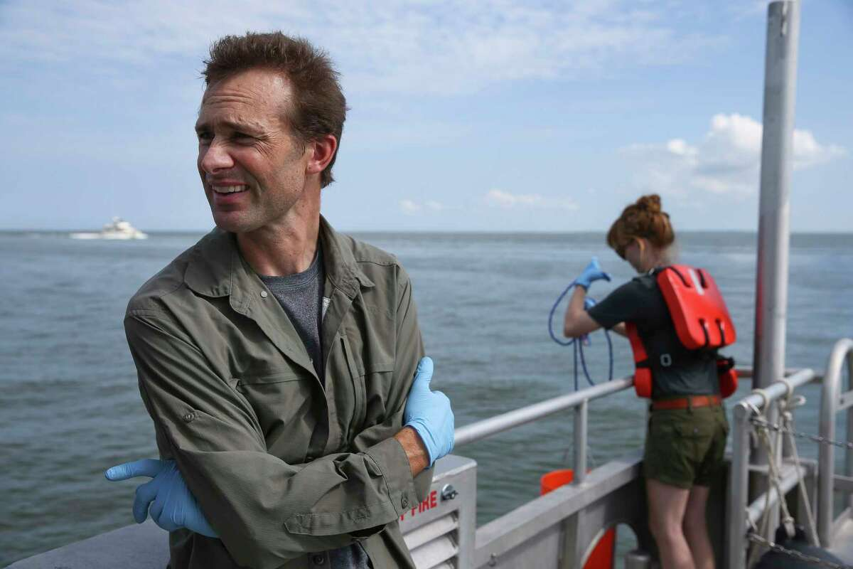 Texas A&M University at Galveston assistant professor Karl Kaiser is testing water at different sites from Morgan's Point to determine how far into Galveston Bay contamination has reached.