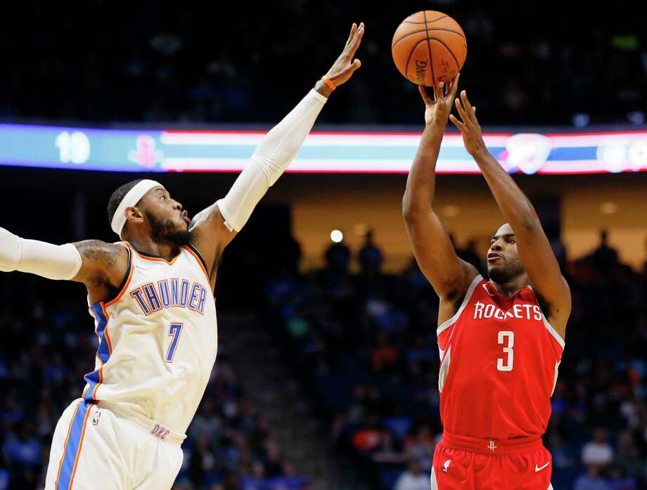 Two high-profile offseason acquisitions - the Thunder's Carmelo Anthony, left, and the Rockets' Chris Paul - square off Tuesday. Photo: Sue Ogrocki, STF / AP2017