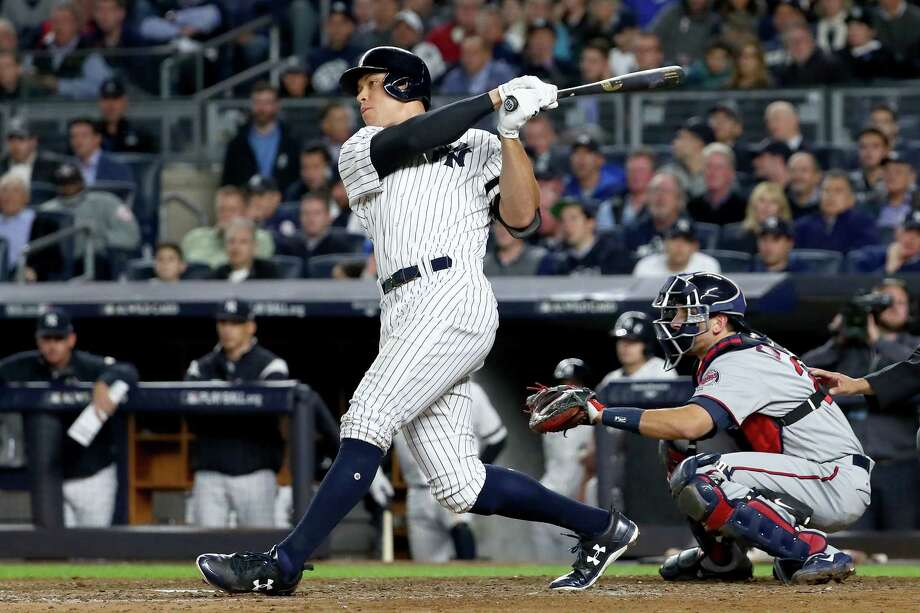 NEW YORK, NY - OCTOBER 03:  Aaron Judge #99 of the New York Yankees hits a two run home run against Jose Berrios #17 of the Minnesota Twins during the fourth inning in the American League Wild Card Game at Yankee Stadium on October 3, 2017 in the Bronx borough of New York City.  (Photo by Al Bello/Getty Images) ORG XMIT: 775053345 Photo: Al Bello / 2017 Getty Images