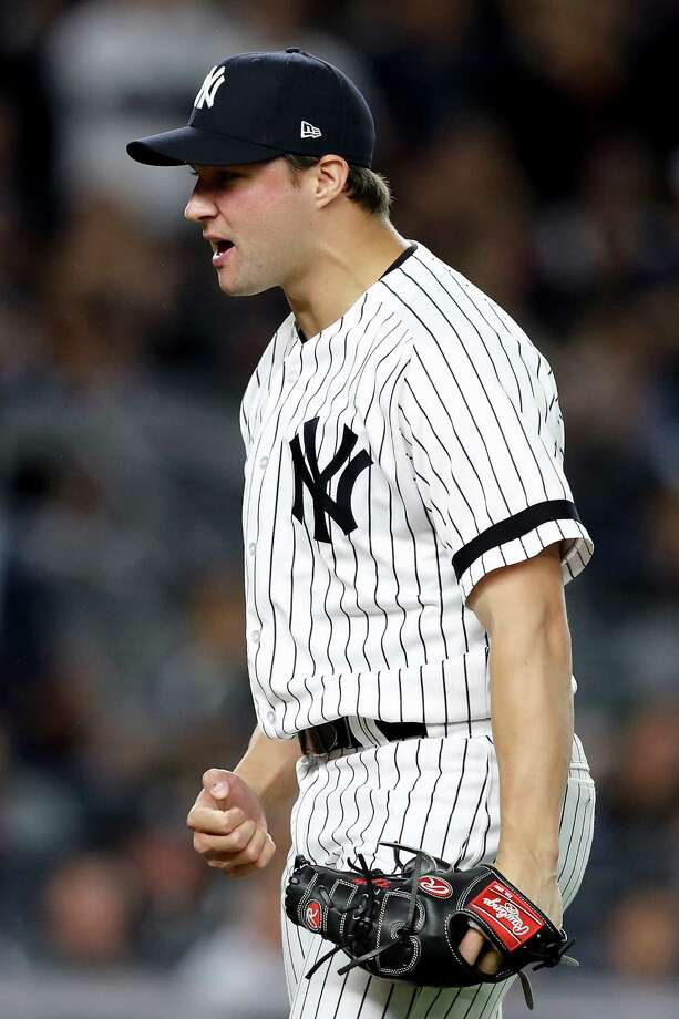 Latham native Tommy Kahnle of the Yankees celebrates the final out of the top of the seventh inning against the Minnesota Twins in the American League Wild Card Game at Yankee Stadium on Tuesday. (Photo by Elsa/Getty Images) ORG XMIT: 775053345 Photo: Elsa / 2017 Getty Images