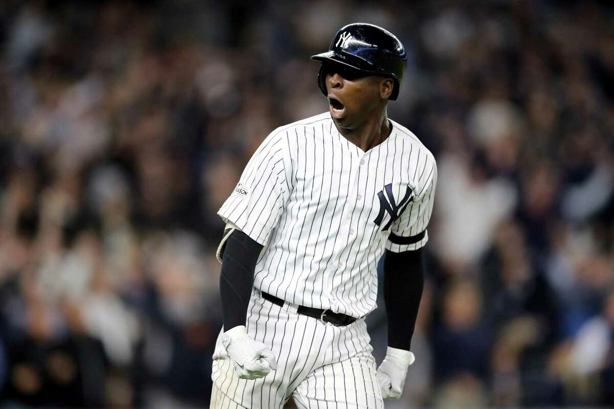 NEW YORK, NY - OCTOBER 03: Didi Gregorius #18 of the New York Yankees celebrates after hitting a three run home run against Ervin Santana #54 of the Minnesota Twins during the first inning in the American League Wild Card Game at Yankee Stadium on October 3, 2017 in the Bronx borough of New York City. (Photo by Elsa/Getty Images)