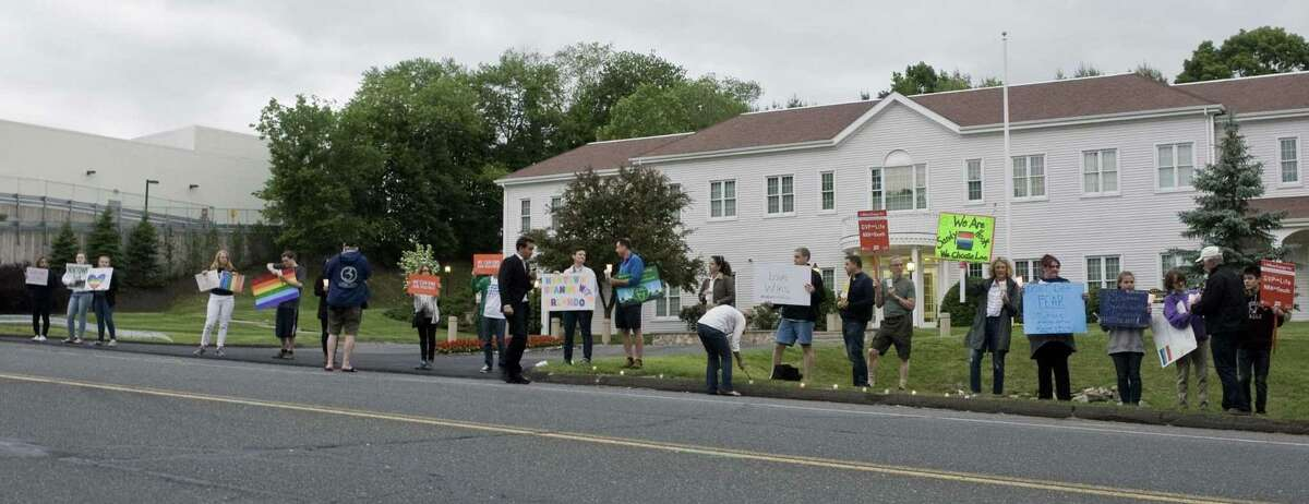 Newtown Action Alliance holds a candlelight vigil to show solidarity for the Orlando community. The vigil is in front of the National Shooting Sports Foundation headquarters in Newtown. Sunday, June 12, 2016