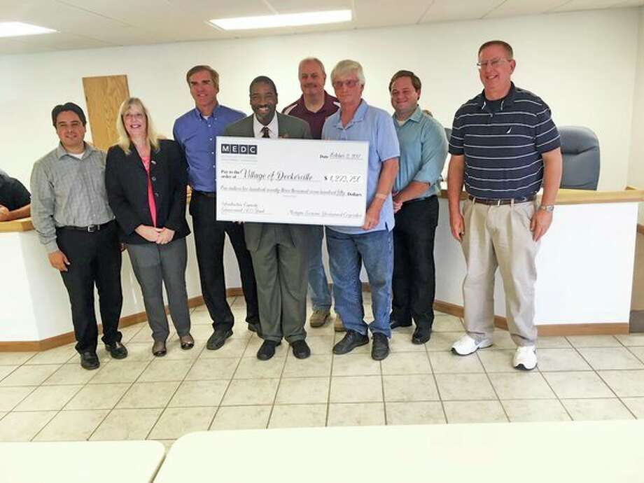 Village of Deckervilleofficials accept aninfrastructure improvement grant on Monday. (Submitted Photo)
