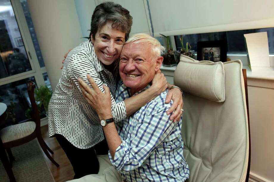 Joachim Frank, of Columbia University, is hugged by his wife Carol Saginaw, in their New York City apartment, Wednesday, Oct. 4, 2017. Frank shares this year's Nobel Chemistry Prize with two other researchers for developing a method to generate three-dimensional images of the molecules of life. (AP Photo/Richard Drew) ORG XMIT: NYRD101 Photo: Richard Drew, AP / AP