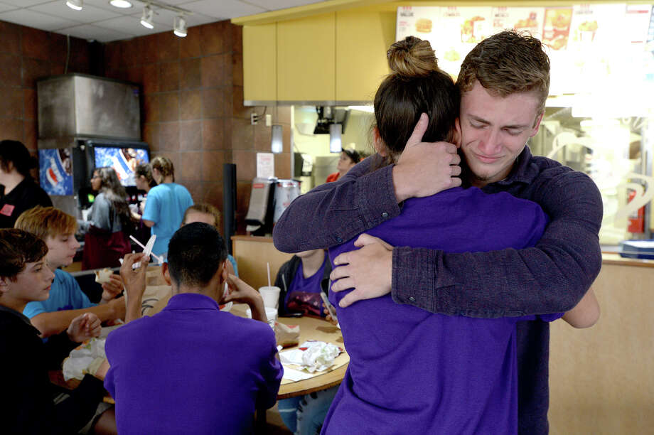 Colby Watts and Autumn Roundtree console one another as they become emotional while joining in the gathering  at Taco Bell, where a number of Silsbee High School students met following a vigil in honor of Tristan Dilley at Silsbee High School Tuesday.  The restaurant was Tristan's favorite, and it was quickly filled early in the evening with students wearing commemorative t-shirts, laughing as they shared memories of their friend, and consoling one another as they continue dealing with their loss. Photo taken Tuesday, October 3, 2017 Kim Brent/The Enterprise Photo: Kim Brent / BEN