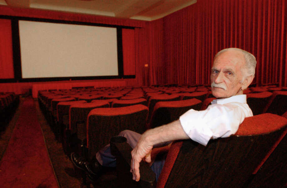 W.S. Rosser, longtime manager of the Pines Theater, poses for a photo in the theater in 2001. Rosser was known to generations of Silsbee residents while running the theater for more than 65 years.  Enterprise file photo Photo: Jennifer Reynolds, Staff Photographer / The Beaumont Enterprise