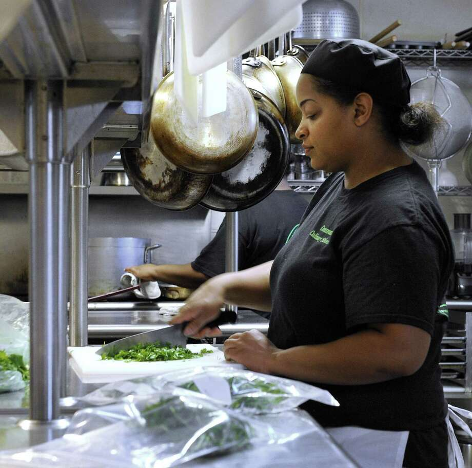 Lindsay Carter, 30, of Danbury, chops cilantro at the the Culinary School of Northwest Connecticut in New Milford on Wednesday. Photo: Carol Kaliff / Hearst Connecticut Media / The News-Times