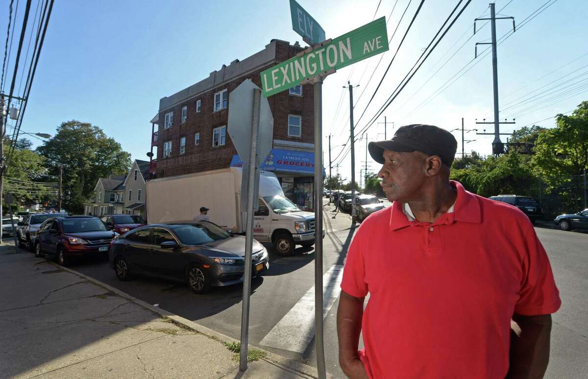 Ernie Dumas, president of South Norwalk Citizens for Justice, stands at the corner of Ely and Lexington avenues Tuesday, where illegally parked cars, narrow streets and truck and bus traffic make for dangerous conditions.