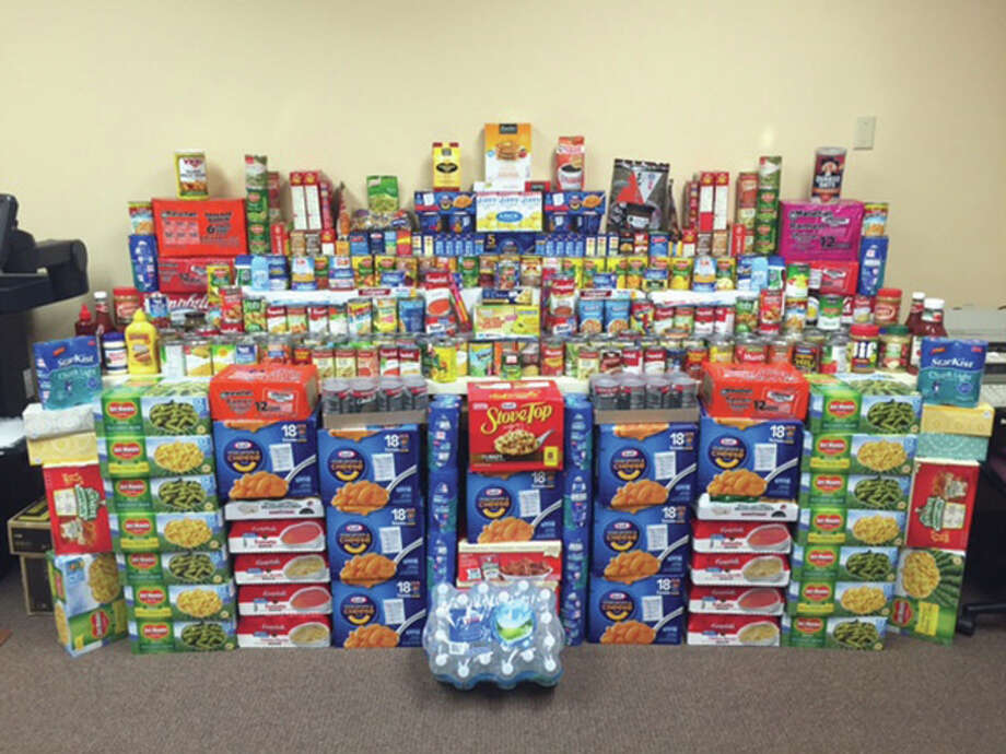 The results of Scheffel Boyle CPAs Edwardsville office's food drive collection. Photo: For The Intelligencer