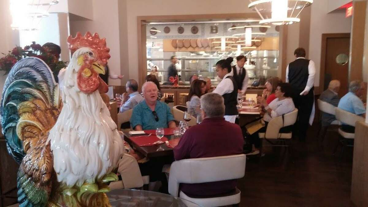 A rooster oversees the dining room at Bocuse.