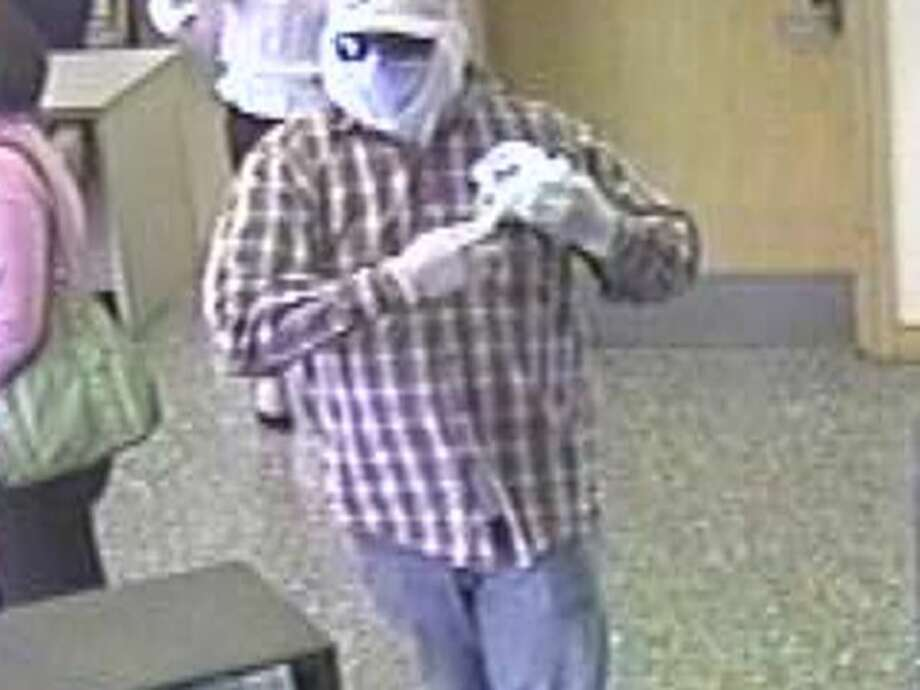 """The San Antonio Police Department and the FBI are seeking the public's help in finding a suspect referred to as the """"Camry Cruzin Bandit,"""" who is wanted in connection with multiple North Side bank robberies beginning in 2013. Photo: FBI"""