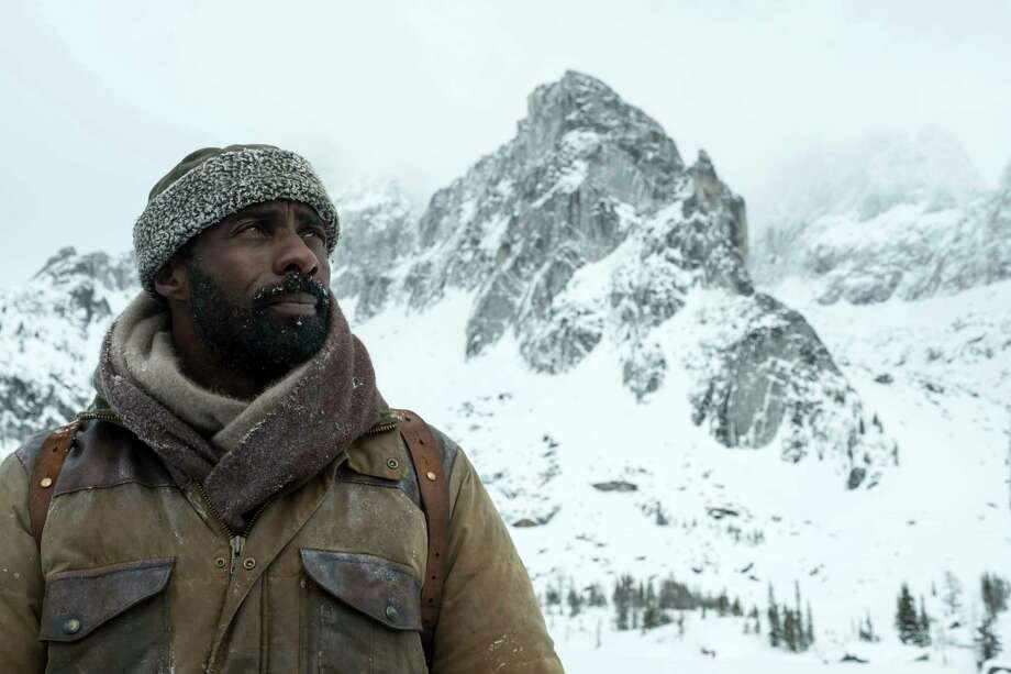 """This image released by Twentieth Century Fox shows Idris Elba in a scene from """"The Mountain Between Us."""" (Kimberley French/Twentieth Century Fox via AP) Photo: Kimberley French, HONS / TM & © 2017 Twentieth Century Fox Film Corporation. All Rights Reserved. Not for sale or duplication."""