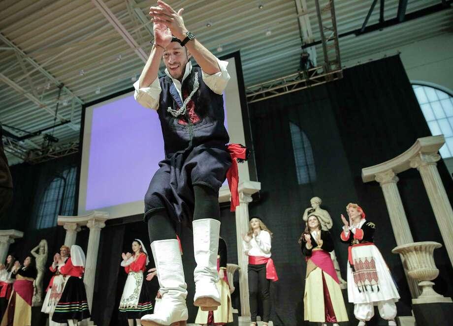 William Venzke performs a traditional Greek dance during The Original Greek Festival hosted by Annunciation Greek Orthodox Church. Photo: Elizabeth Conley, Staff / © 2016 Houston Chronicle