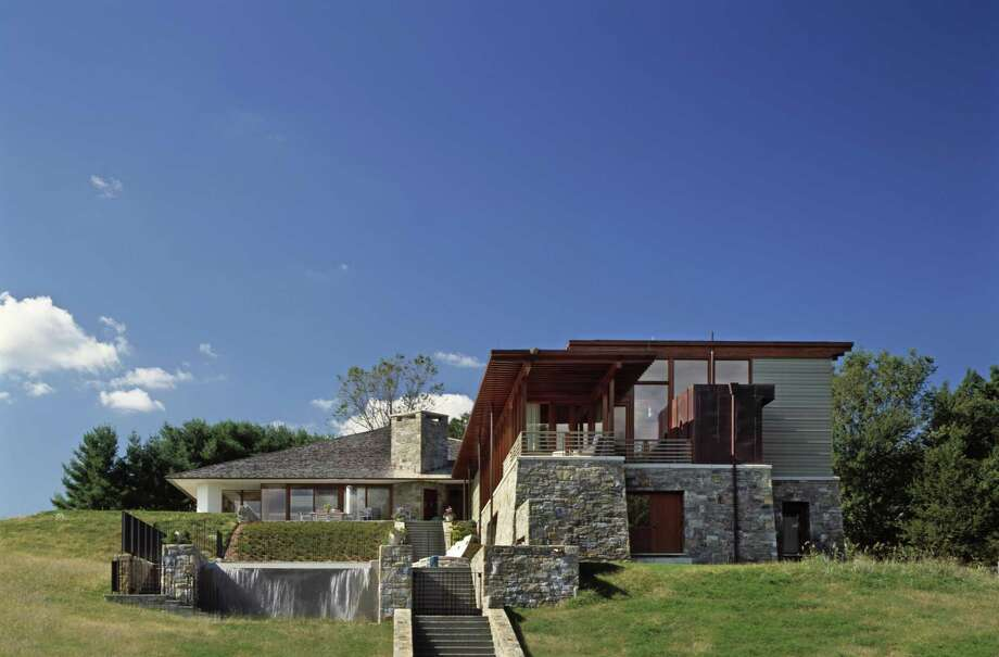 The 9,563-square-foot contemporary house at 121 Middlebrook Farm Road sits on a 4.92-acre level and gently sloping parcel atop a hill.  It was designed by Architect Ike Kligerman Barkley; Location Photo: Peter Aaron / Peter Aaron / ©2004 PeterAaron/OTTO