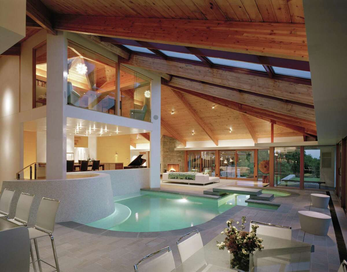 This house enjoys two swimming pools, one of which is an indoor salt water pool between the kitchen and living room.
