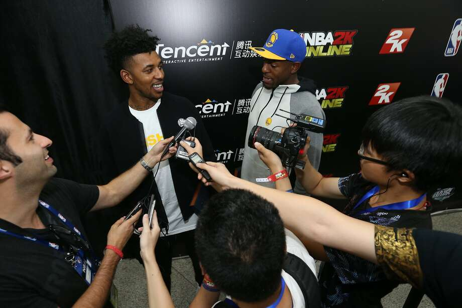 Nick Young and Andre Iguodala are interviewed by reporters Wednesday night in Shenzhen, China. Photo: Courtesy Of NBAE, NBAE/Getty Images