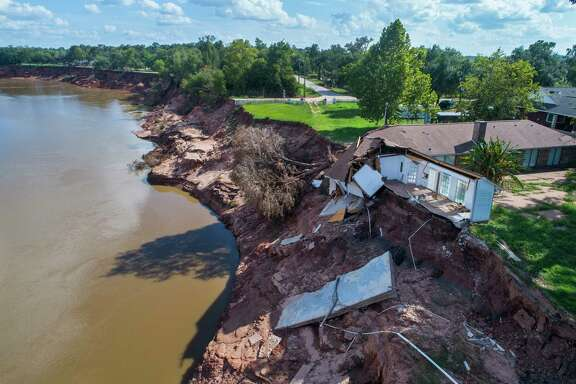 A house that was already condemned is now hanging into the Brazos River in Simonton. The house was not falling into the river before Hurricane Harvey.