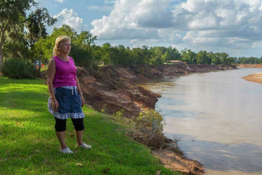 Sharon Galavitz has seen even more of her property along the Brazos River disappear in the wake of Hurricane Harvey in Simonton. Galavitz's home was also flooded during the storm. Photo: Mark Mulligan, Houston Chronicle / 2017 Mark Mulligan / Houston Chronicle