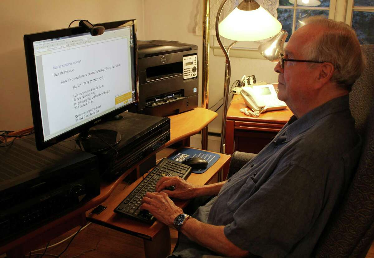 Gordon Nugent, 91, edits his poem about President Donald Trump inside his Wilton home.