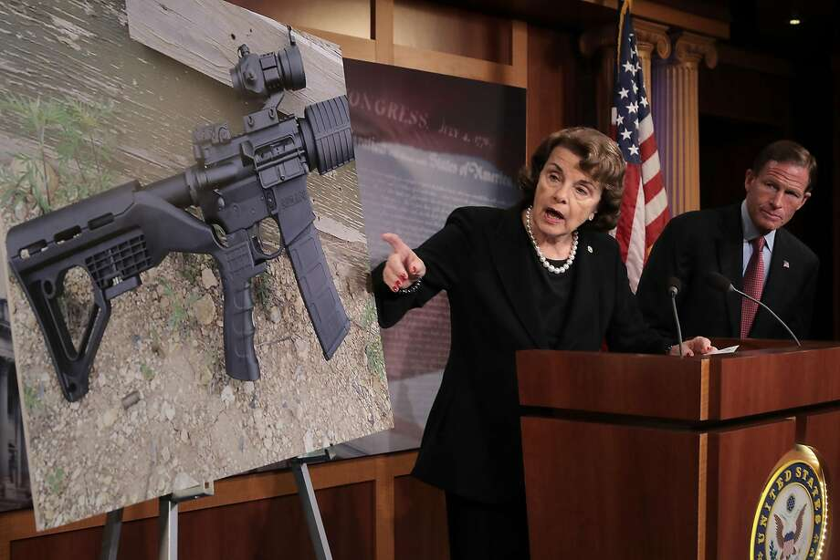 """Sen. Dianne Feinstein (D-CA) (C) and Sen. Richard Blumenthal (D-CT) points to a photograph of a rifle with a """"bump stock"""" during a news conference to announce proposed gun control legislation at the U.S. Capitol October 4, 2017 in Washington, DC. In reaction to Sunday's mass shooting in Las Vegas that left 59 people dead and hundreds injured, Feinstein's legislation would ban devices that could make weapons fully automatic. (Photo by Chip Somodevilla/Getty Images) Photo: Chip Somodevilla, Getty Images"""