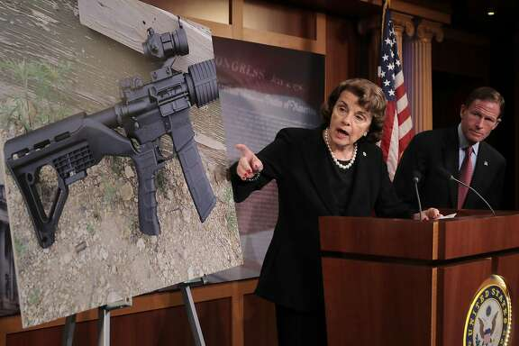 "WASHINGTON, DC - OCTOBER 04:  Sen. Dianne Feinstein (D-CA) (C) and Sen. Richard Blumenthal (D-CT) points to a photograph of a rifle with a ""bump stock"" during a news conference to announce proposed gun control legislation at the U.S. Capitol October 4, 2017 in Washington, DC. In reaction to Sunday's mass shooting in Las Vegas that left 59 people dead and hundreds injured, Feinstein's legislation would ban devices that could make weapons fully automatic.  (Photo by Chip Somodevilla/Getty Images)"