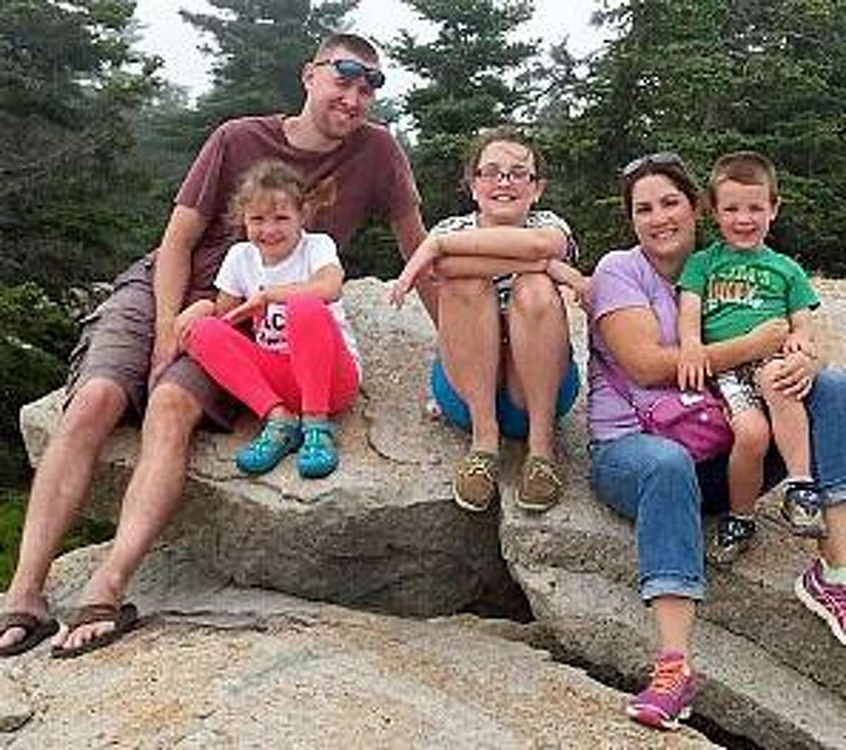 The late Danbury police Sgt. Drew Carlson with his family