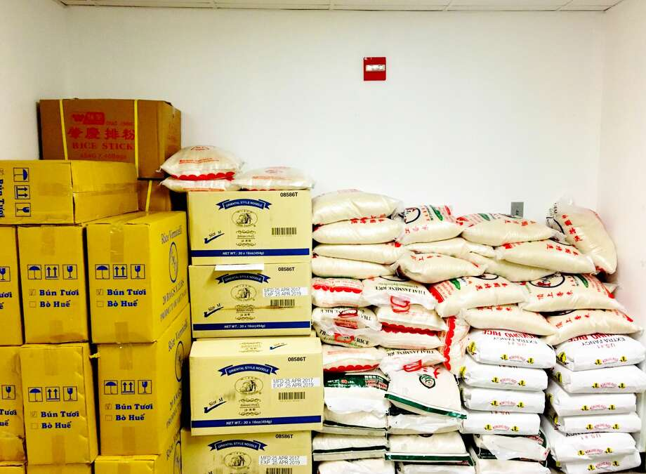 Piles of donated rice and rice noodles at the Midtown Kitchen Collective. Photo: David Leftwich