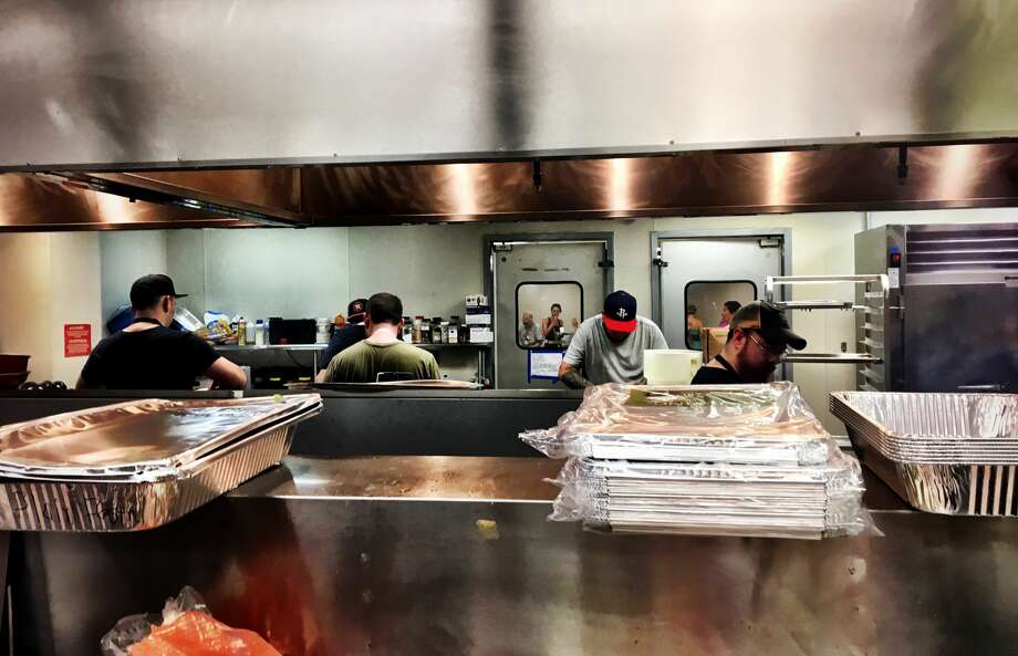 Chefs and other volunteers prepared more than 250,000 meals at the Midtown Kitchen Collective. Photo: David Leftwich