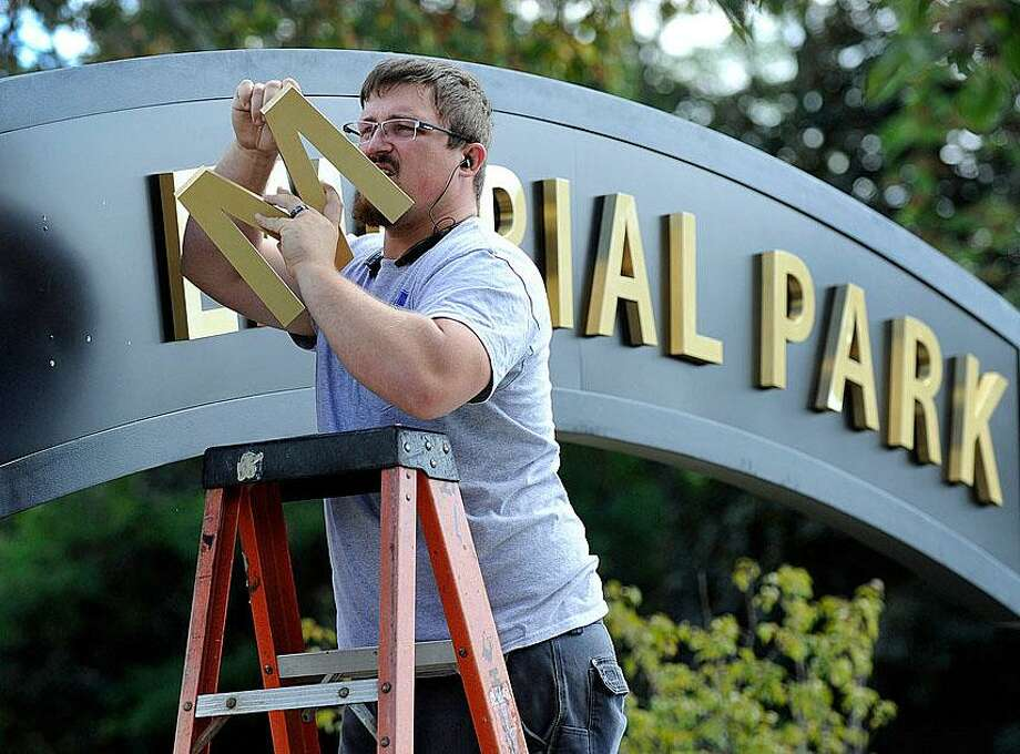 Putting the finishing touches on Memorial Park on Main Street. Photo: / Carol Kaliff
