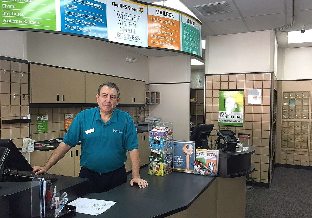 """Morkos """"Mark"""" Hanna behind the counter of his new The UPS Store in Danbury, Conn., on Monday, Oct. 2, 2017."""