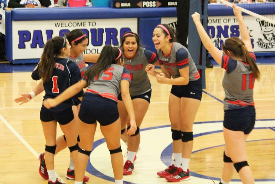 Members of the Plainview volleyball team celebrate a point during a District 3-5A match against Palo Duro in Amarillo Tuesday night. Photo: Carmen Ortega/Plainview Herald