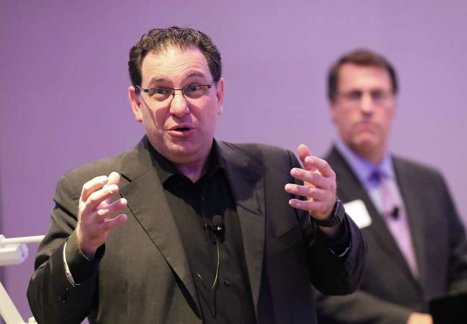 Kevin Mitnick, a noted hacker who was once on the FBI's Most Wanted list speaks to a group moderated by Mark W. Montgomery, Houston City President BBVA Compass, Tuesday, Oct. 3, 2017, in Houston. Mitnick has become a security consultant to governments and major corporations addressing cybersecurity. ( Steve Gonzales / Houston Chronicle ) Photo: Steve Gonzales, Houston Chronicle / © 2017 Houston Chronicle