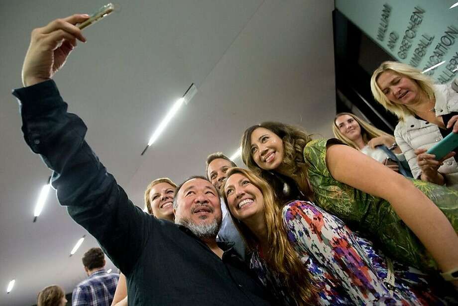 "Ai Weiwei takes selfies with fans after showing of ""Human Flow."" Photo: Tommy Lau, With Permission To The San Francisco Chronicle"