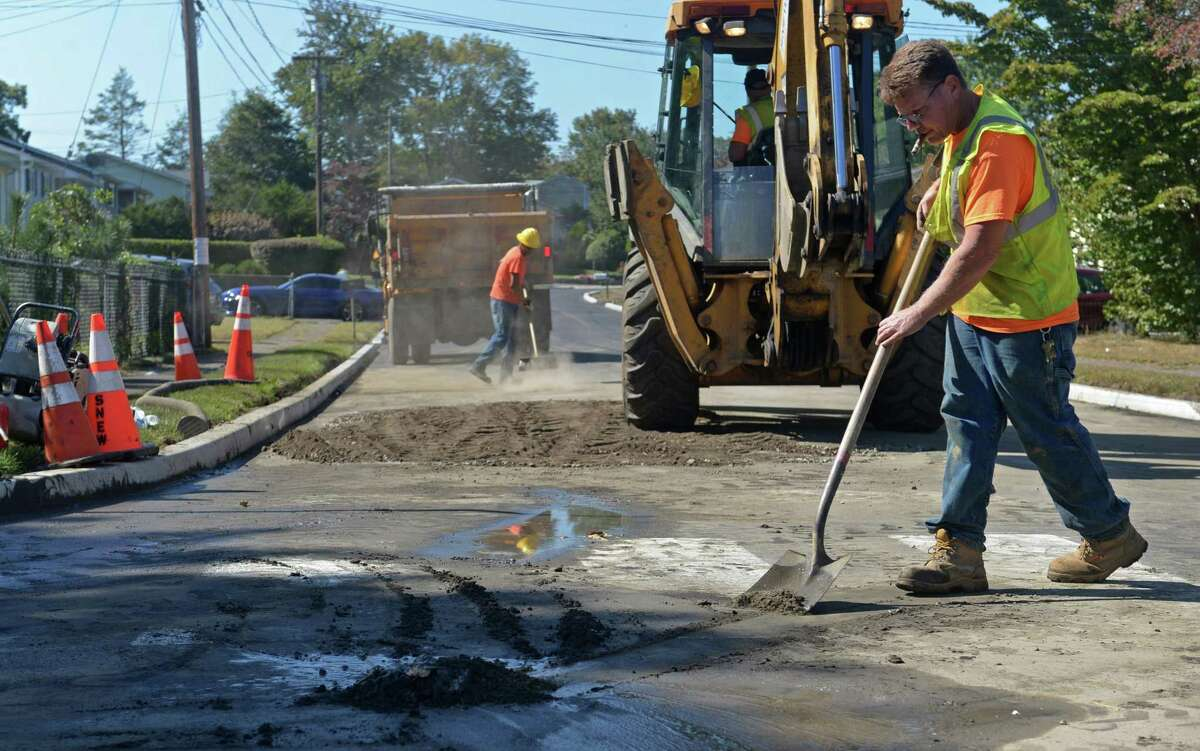 South Norwalk Electrical Works employees repair the street where a water main broke early Wednesday morning on Southwind Drive in Norwalk.