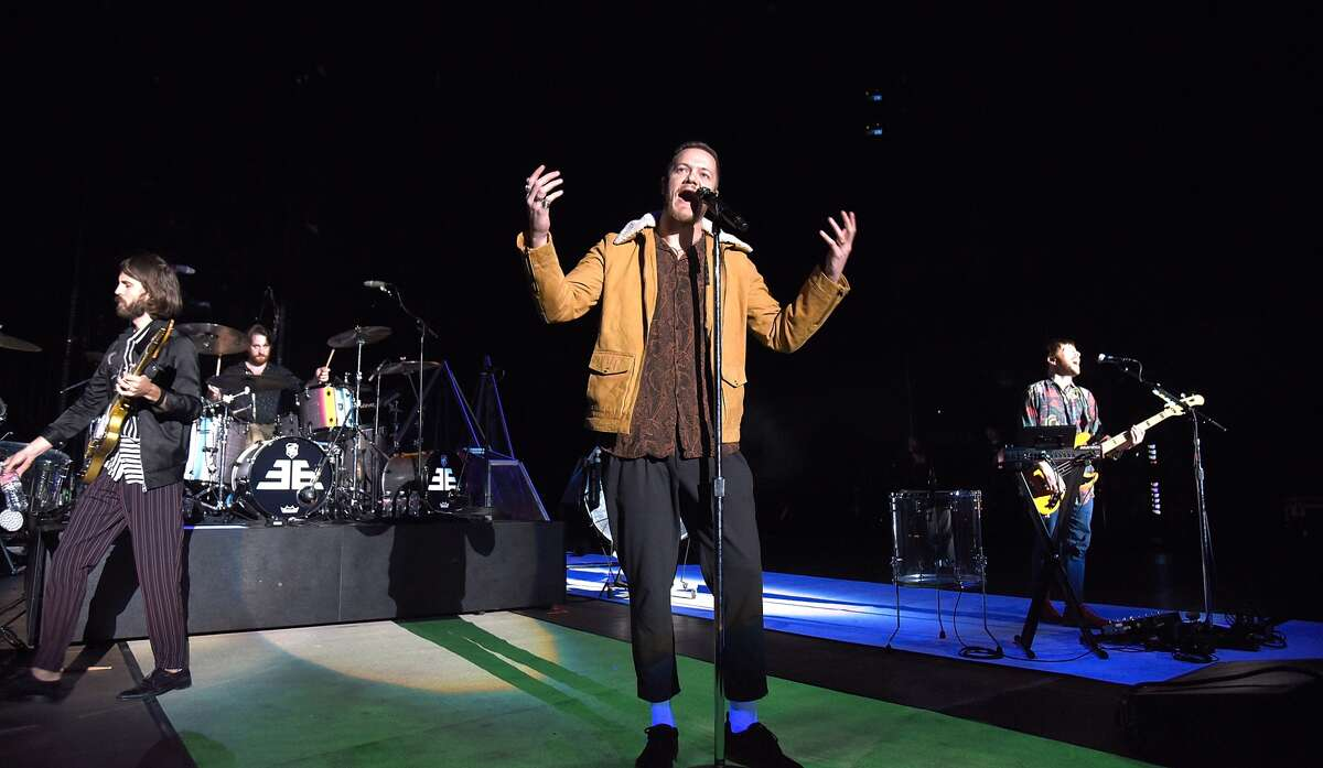Guitarist Wayne Sermon, frontman Dan Reynolds and Ben McKee of Imagine Dragons perform during a stop of the band's Evolve World Tour at Shoreline Amphitheatre on October 3, 2017 in Mountain View, California.