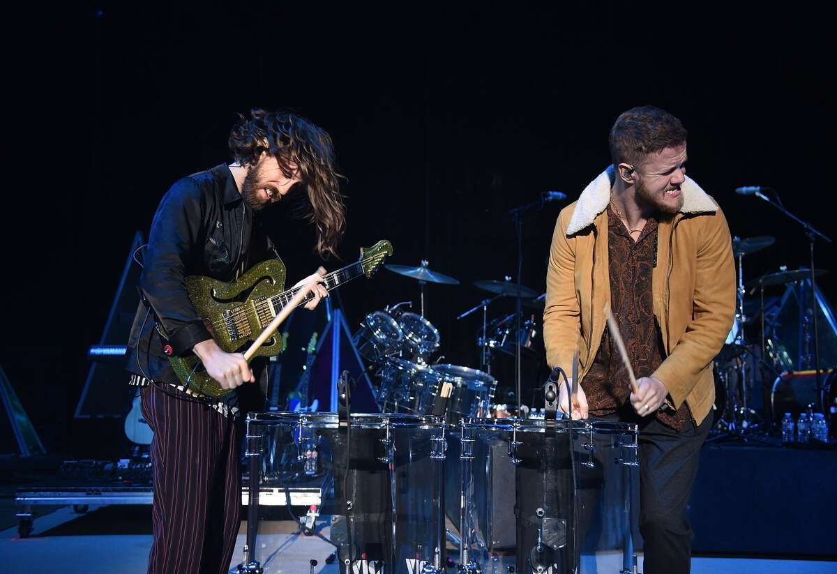 Guitarist Wayne Sermon (L) and frontman Dan Reynolds of Imagine Dragons perform during a stop of the band's Evolve World Tour at Shoreline Amphitheatre on October 3, 2017 in Mountain View, California.