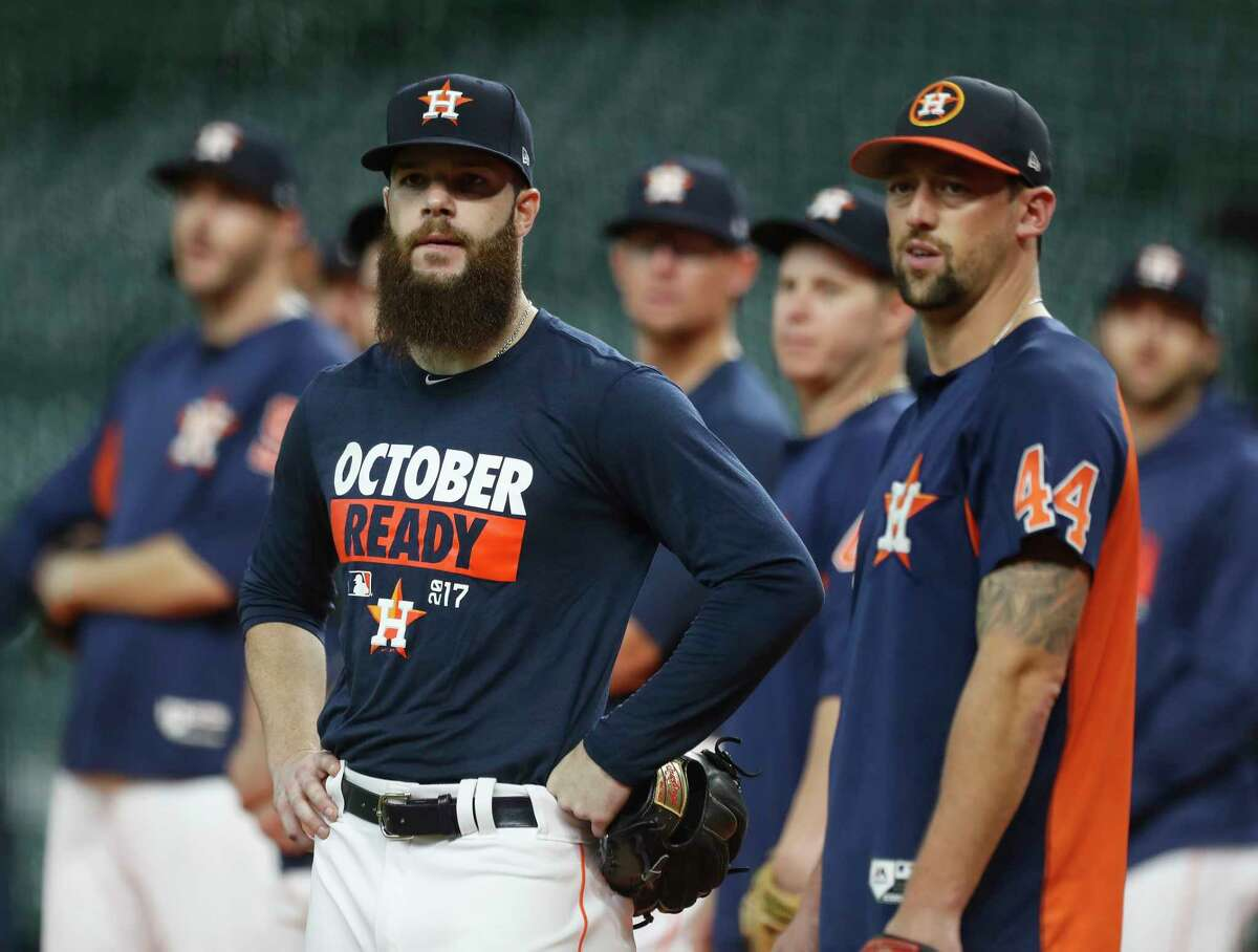 Houston Astros starting pitcher Dallas Keuchel talks with Luke Gregerson during the Astros batting practice at Minute Maid Park, Tuesday, Oct. 3, 2017, in Houston, as they prepare to take on the Boston Red Sox in teh ALDS playoffs.