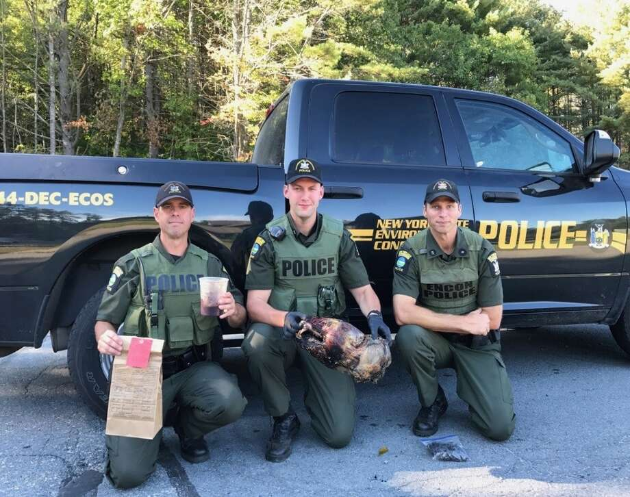 On Sept. 22, three officers from the state Department of Environmental Conservation investigated an illegal bear that was shot in Saratoga County. The bear skull, meat and gall bladder were seized as evidence. Photo: Courtesy Of The New York Department Of Environmental Conservation