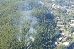 An aerial photo that was taken of the brush fire in Terra Haute in Bethel Wednesday taken as crews were attempting to asses the area under fire.