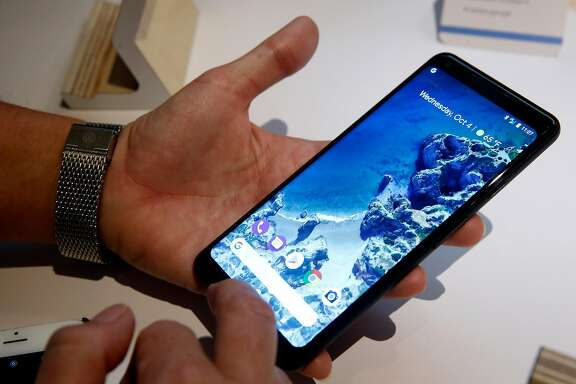 A guest examines a new Google Pixel 2 mobile phone after a news conference in San Francisco, Calif. on Wednesday, Oct. 4, 2017.