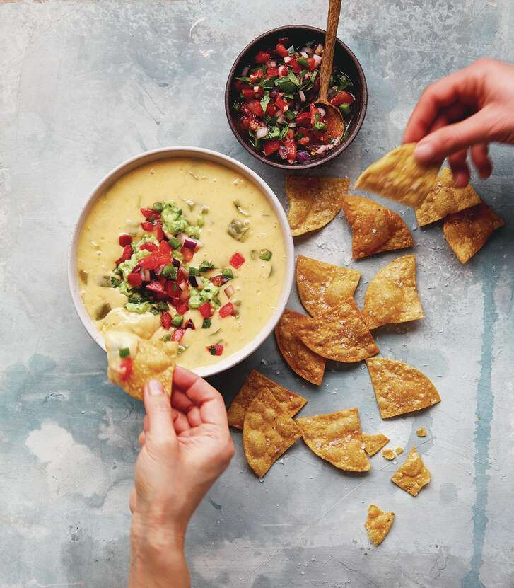 """Austin Diner Style Queso from """"Queso! Regional Recipes for the World's Favorite Chile-Cheese Dip"""" by Lisa Fain (Ten Speed Press, $15)."""