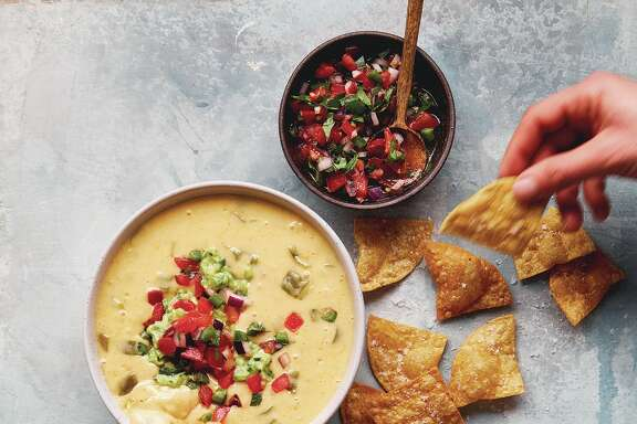 "Austin Diner Style Queso from  ""Queso! Regional Recipes for the World's Favorite Chile-Cheese Dip"" by Lisa Fain (Ten Speed Press, $15)."