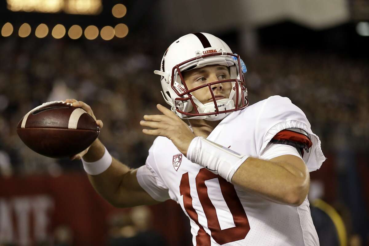 Stanford quarterback Keller Chryst warms up on the sidelines during the first half of an NCAA college football game against San Diego State Saturday, Sept. 16, 2017, in San Diego. (AP Photo/Gregory Bull)