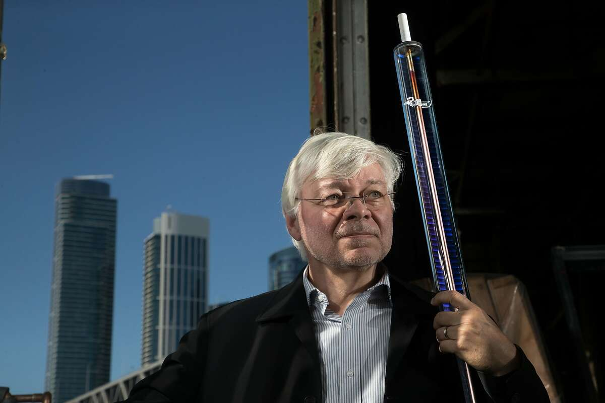 Wolfgang Weiss of ergsol holds a glass solar collector on Monday, Oct. 2, 2017 in San Francisco, Calif. The collector consists of a glass enclosed modified copper tube.