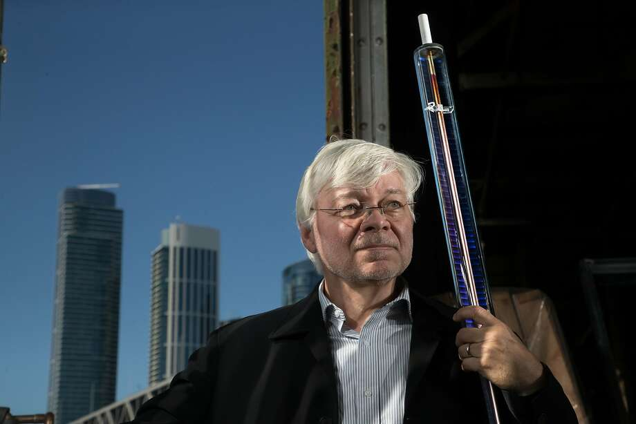 Wolfgang Weiss of ergsol holds a glass solar collector on Monday, Oct. 2, 2017 in San Francisco, Calif. The collector consists of a glass enclosed modified copper tube. Photo: Paul Kuroda, Special To The Chronicle