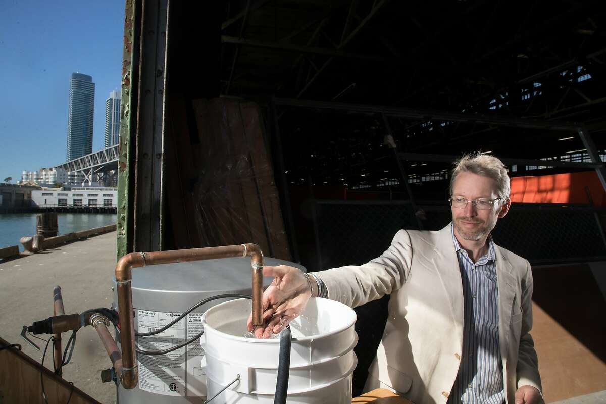 Cole Roberts, ARUP Associate Principal, feels the warm water heated by their solar collector on Monday, Oct. 2, 2017 in San Francisco, Calif.