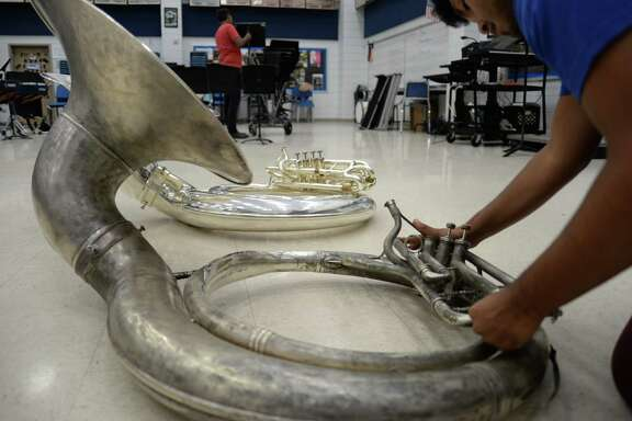 A Sam Rayburn High School senior assembles a school-owned sousaphone that dates to 1965.  Pasadena ISD hopes to use $1 million from a $135 million bond package on the  Nov. 7 ballot to purchase band and orchestra instruments.